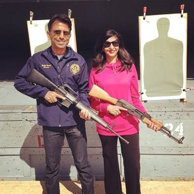 JINDAL AND WIFE WITH GUNS